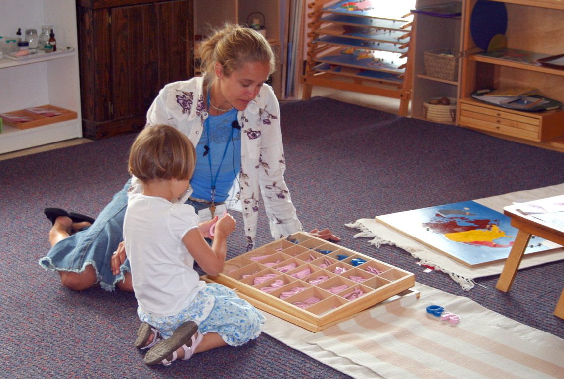 Montessori teacher with student